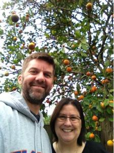 Vicki Poole and me in front of her orange tree.
